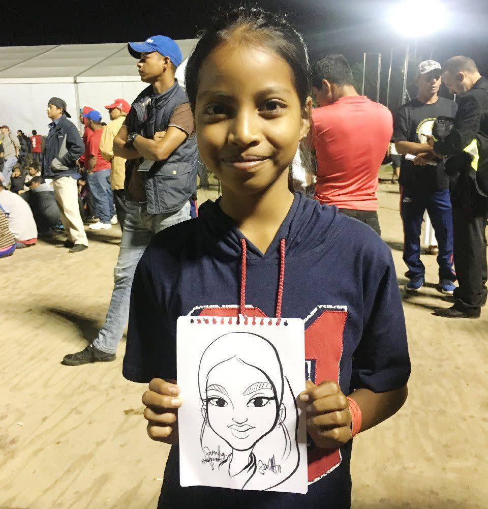 Sarahi, 8, is from Honduras and traveling with her family. She likes to draw and enjoys school. She says that the journey is tough, but seeing a lot of other kids makes her feel at ease.