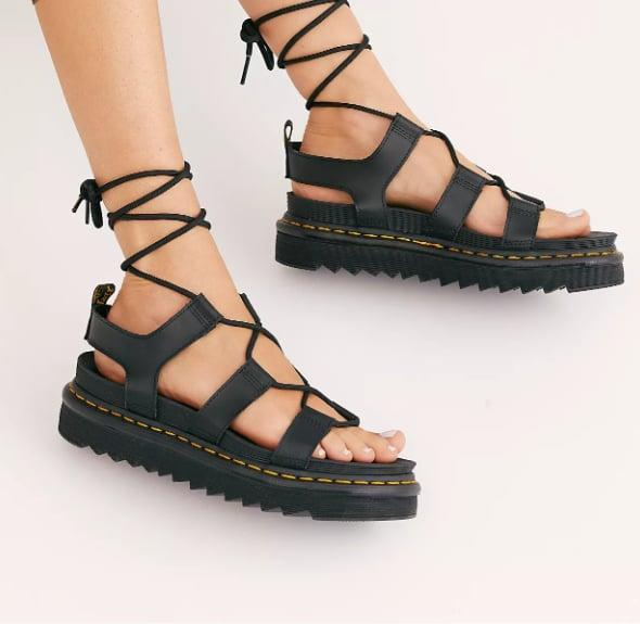 "<p>Leave it to Dr. Martens to do the perfect flatform sandal. </p> <p><a href=""https://www.popsugar.com/buy/Dr-Martens-Nartilla-Flatform-Sandals-573190?p_name=Dr.%20Martens%20Nartilla%20Flatform%20Sandals&retailer=freepeople.com&pid=573190&price=100&evar1=fab%3Aus&evar9=47446893&evar98=https%3A%2F%2Fwww.popsugar.com%2Ffashion%2Fphoto-gallery%2F47446893%2Fimage%2F47463645%2FDr-Martens-Nartilla-Flatform-Sandals&list1=sandals%2Cshoes%2Ctrends%2Csummer%2Cfashion%20shopping&prop13=mobile&pdata=1"" class=""link rapid-noclick-resp"" rel=""nofollow noopener"" target=""_blank"" data-ylk=""slk:Dr. Martens Nartilla Flatform Sandals"">Dr. Martens Nartilla Flatform Sandals</a> ($100)</p>"