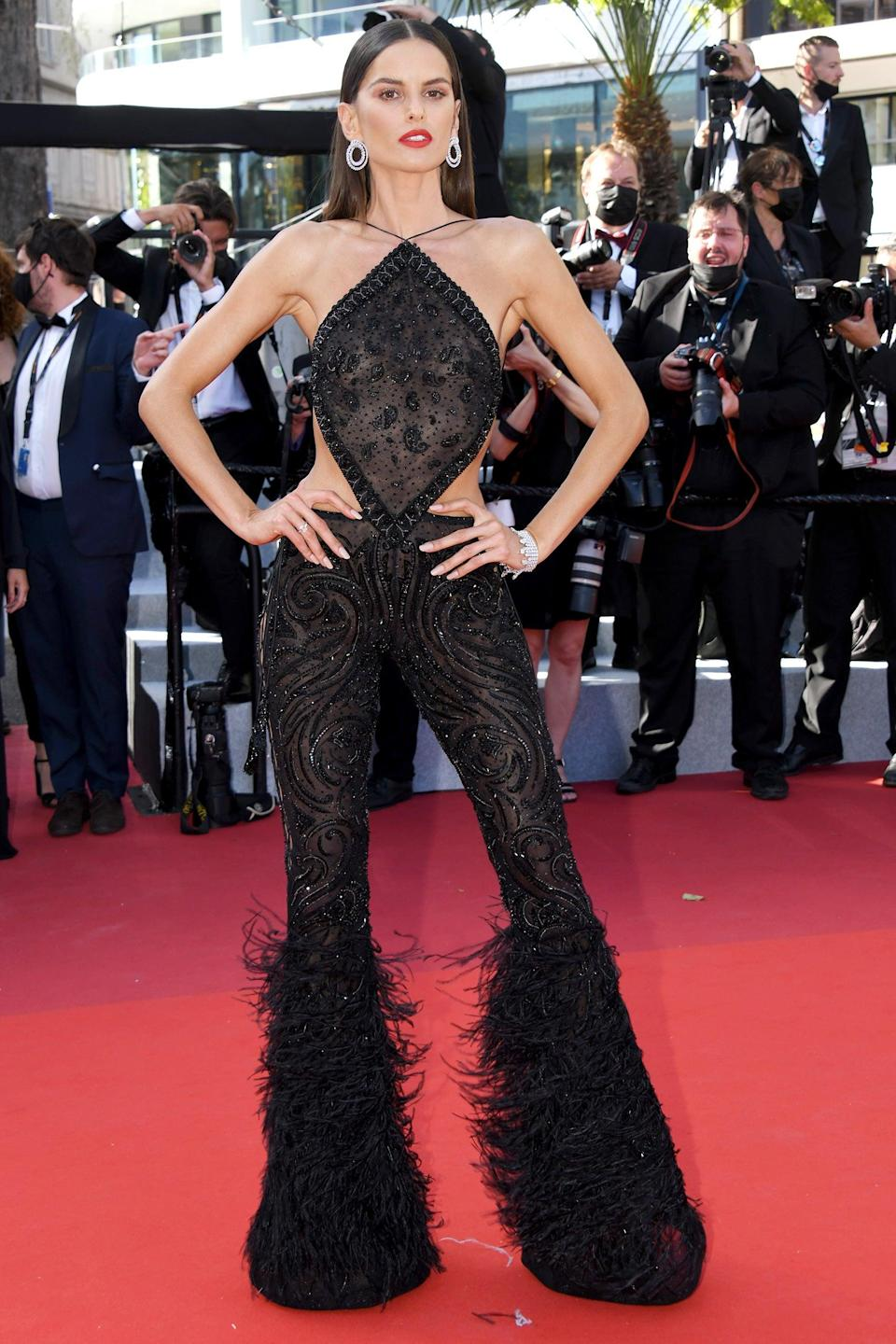 """Izabel Goulart went retro in a black halter jumpsuit with side cut-outs by Etro. <span class=""""copyright"""">Photo: Lionel Hahn/Getty Images.</span>"""