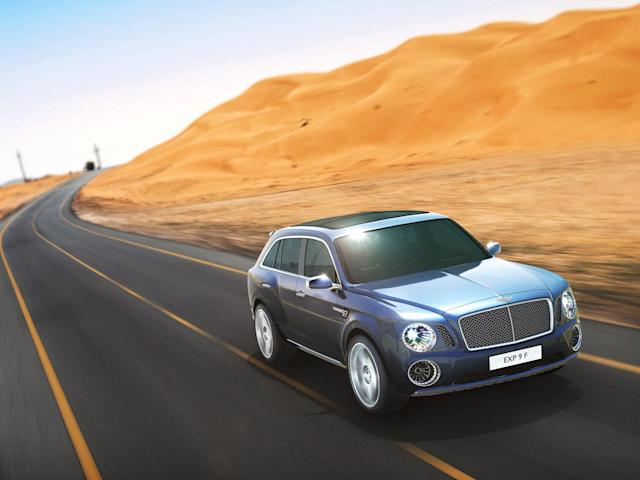 After months of rumors, Bentley revealed today a concept for its first sport utility vehicle ever: the 600-hp Bentley EXP 9 F. When it comes to vehicles for the wealthiest people in the world, restraint is so last century. With ultra-luxury vehicle sales rising on strong demand from China and the Middle East, the SUV would make the most financial sense as an addition. Given that the Continental starts around $190,000 and the Mulsanne around $280,000, it's easy to imagine a Bentley SUV with a sticker of about $250,000. Powered by a twin-turbo W-12 capable of 600 hp and 590 ft-lbs. of torque, Bentley says the EXP 9 would rank among the fastest vehicles of its kind. All that motive force gets to the ground through an 8-speed transmission and all-wheel-drive system turning 23-inch chrome wheels that are as bling-y as anything from Tire Rack. Inside lies the usual assortment of hand-stitched leathers, wood veneers and one-percentery touches like a split tailgate that folds down to reveal a custom dining set.