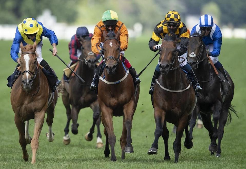 ockey Kevin Stott rides Hello Youmzain (2R checks) to win The Diamond Jubilee Stakes on day five of the Royal Ascot horse racing meet, in Ascot, on June 20, 2020.