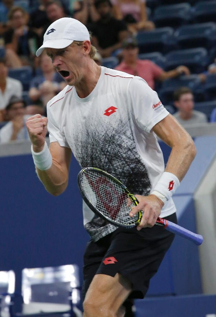 Moving on: Kevin Anderson of South Africa celebrates against Denis Shapovalov (AFP Photo/Kena Betancur)