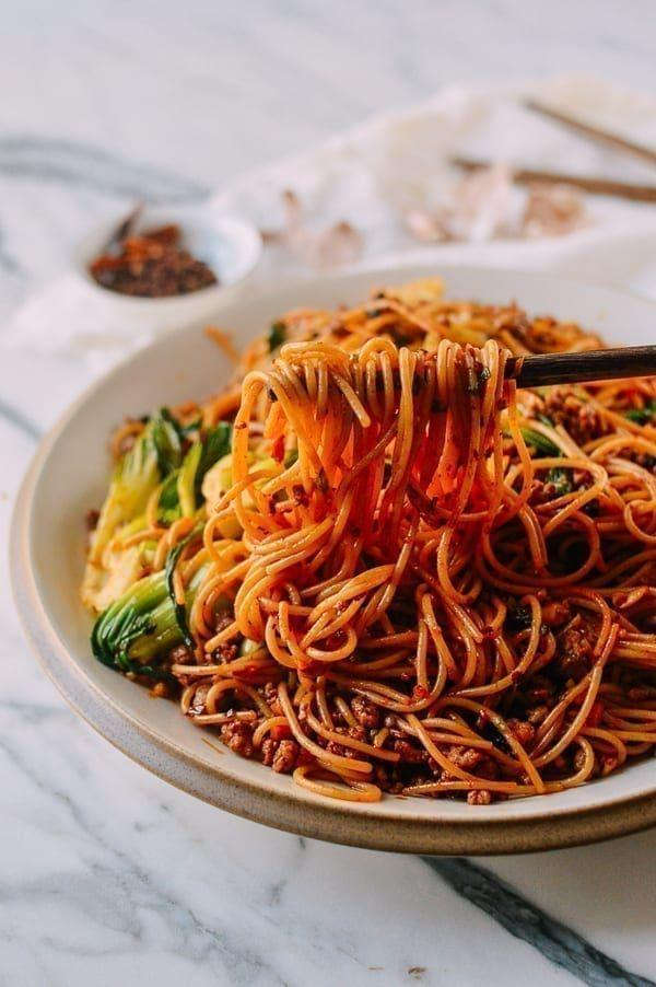 """<p>Crushed peanuts and spicy ground pork give this saucy noodle dish both texture and flavor. It's a fun way to transform a regular box of spaghetti!</p><p><strong>Get the recipe at <a href=""""https://thewoksoflife.com/spicy-crispy-pork-noodles/"""" rel=""""nofollow noopener"""" target=""""_blank"""" data-ylk=""""slk:The Woks of Life"""" class=""""link rapid-noclick-resp"""">The Woks of Life</a>.</strong></p><p><a class=""""link rapid-noclick-resp"""" href=""""https://go.redirectingat.com?id=74968X1596630&url=https%3A%2F%2Fwww.walmart.com%2Fsearch%2F%3Fquery%3Dpioneer%2Bwoman%2Bmeasuring%2Bcups&sref=https%3A%2F%2Fwww.thepioneerwoman.com%2Ffood-cooking%2Frecipes%2Fg37146272%2Fground-pork-recipes%2F"""" rel=""""nofollow noopener"""" target=""""_blank"""" data-ylk=""""slk:SHOP MEASURING CUPS"""">SHOP MEASURING CUPS</a></p>"""