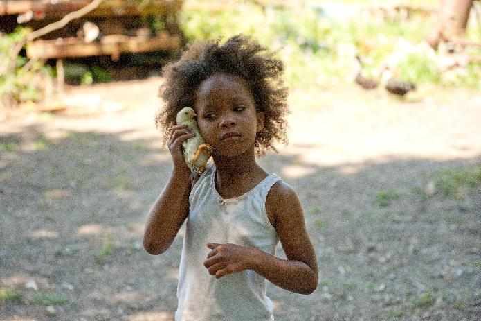"This film image released by Fox Searchlight Pictures shows Quvenzhane Wallis portraying Hushpuppy in a scene from, ""Beasts of the Southern Wild."" (AP Photo/Fox Searchlight Pictures, Jess Pinkham)"