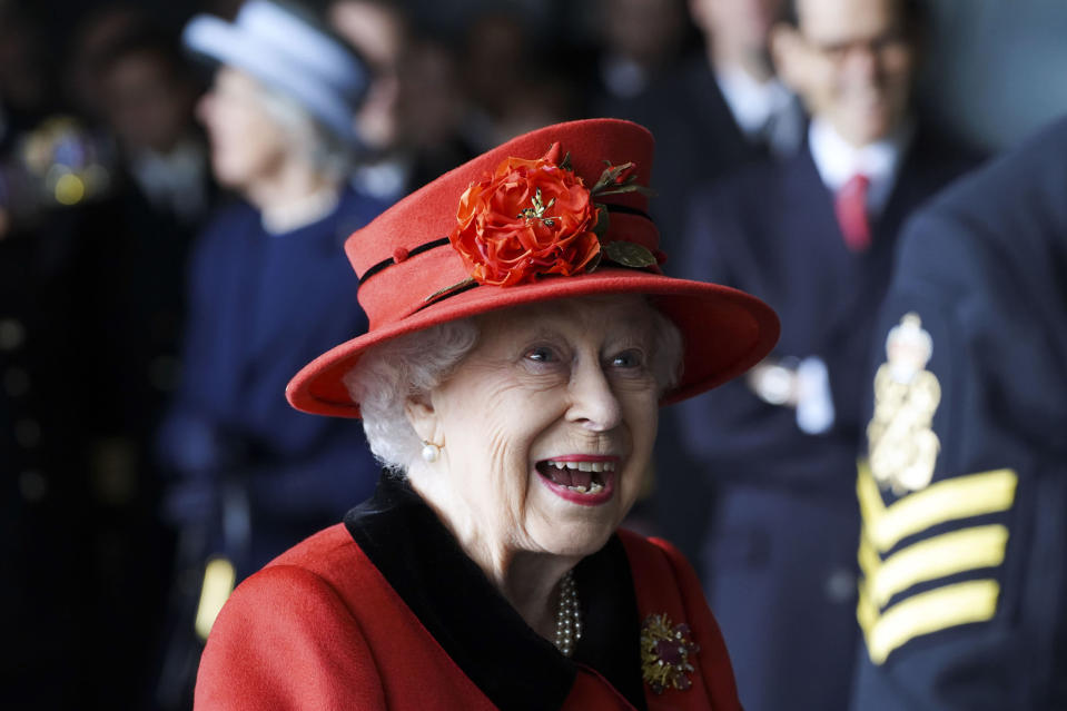 Britain's Queen Elizabeth II visits the HMS Queen Elizabeth at HM Naval Base, ahead of the ship's maiden deployment, in Portsmouth, England, Saturday May 22, 2021. HMS Queen Elizabeth will be leading a 28-week deployment to the Far East that Prime Minister Boris Johnson has insisted is not confrontational towards China. (Steve Parsons/Pool Photo via AP)