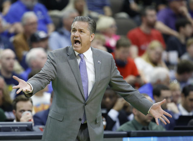 Kentucky head coach John Calipari questions a ruling by an official during the first half against Wofford in a second-round game in the NCAA mens college basketball tournament in Jacksonville, Fla., Saturday, March 23, 2019. (AP Photo/Stephen B. Morton)