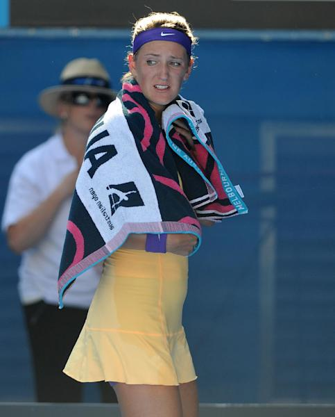 Victoria Azarenka of Belarus leaves Rod Laver Arena for a medical time out during her semifinal match against Sloane Stephens of the US at the Australian Open tennis championship in Melbourne, Australia, Thursday, Jan. 24, 2013. (AP Photo/Andrew Brownbill)