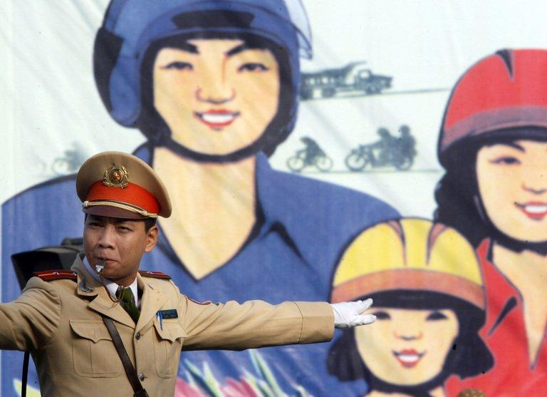 A traffic policeman directs traffic in Hanoi, December 12, 2007