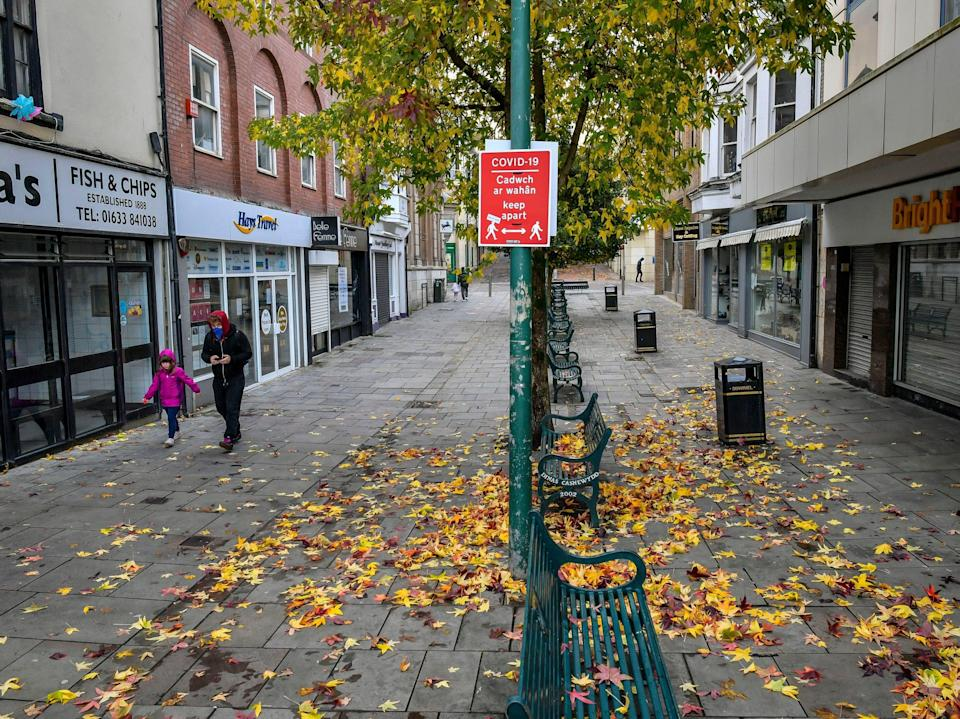 Near-empty streets in the shopping centre of Newport, Wales (PA)