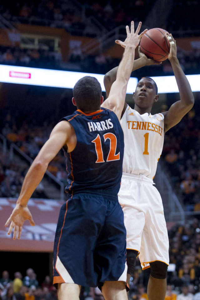 Tennessee's Josh Richardson (1) shoots while defended by Virginia's Joe Harris during an NCAA college basketball game at Thompson-Boling Arena on Monday, Dec. 30, 2013. Richardson totaled 20 points including four from the three-point line. Tennessee won 87-52. (AP Photo/The Knoxville News Sentinel, Saul Young)