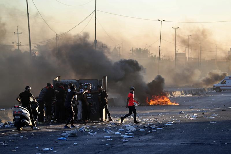 "Anti-government protesters set fires and close a street during a demonstration in Baghdad, Iraq, Friday, Oct. 4, 2019. Security forces opened fire directly at hundreds of anti-government demonstrators in central Baghdad, killing some protesters and injuring dozens, hours after Iraq's top Shiite cleric warned both sides to end four days of violence ""before it's too late."" (AP Photo/Khalid Mohammed)"