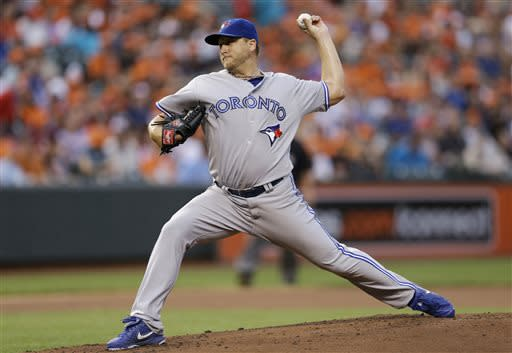 Toronto Blue Jays starting pitcher Mark Buehrle throws to the Baltimore Orioles in the first inning of a baseball game, Friday, July 12, 2013, in Baltimore. (AP Photo/Patrick Semansky)