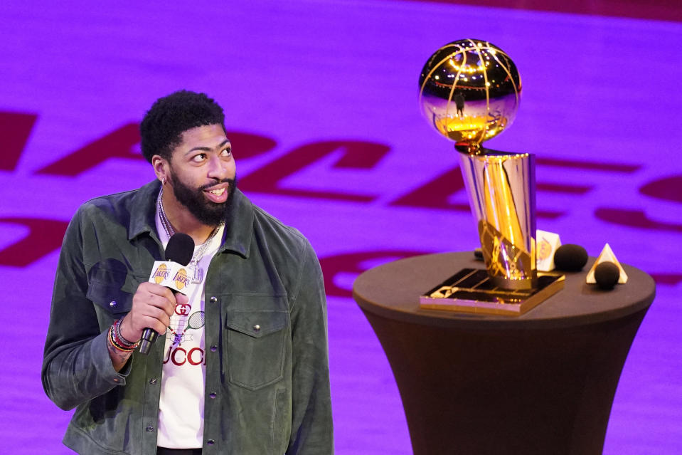 Los Angeles Lakers forward Anthony Davis speaks to the crowd after the Lakers unveiled their 2019-2020 World Championship banner prior to an NBA basketball game against the Houston Rockets Wednesday, May 12, 2021, in Los Angeles. (AP Photo/Mark J. Terrill)