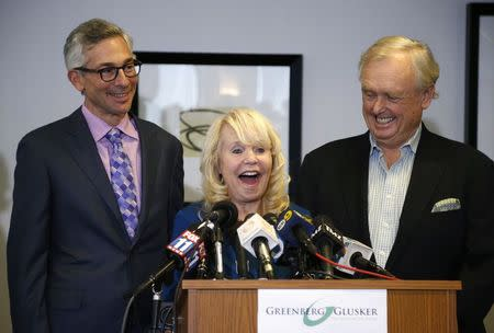 Shelly Sterling, her lawyer Pierce O'Donnell, and Steve Ballmer's lawyer Adam Streisand speak at a news conference to discuss the sale of the Los Angeles Clippers to Steve Ballmer in Los Angeles