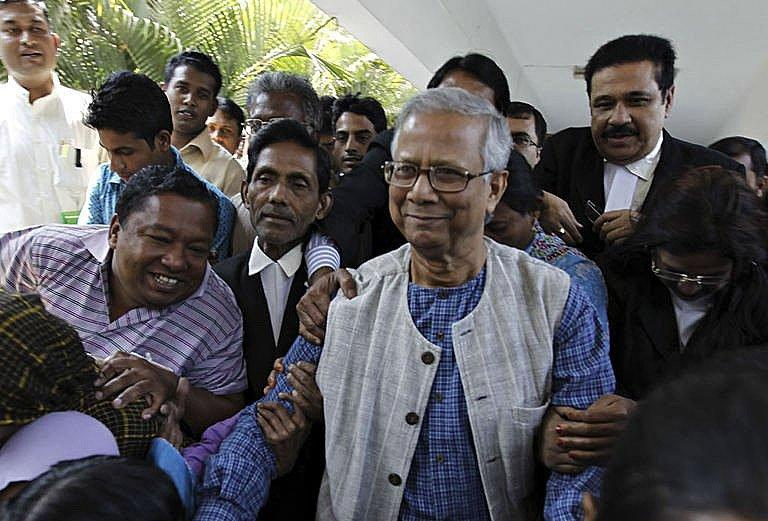 Microfinance pioneer Muhammad Yunus (centre) emergeson Thursday from the high court building where he contested the decision to remove him from his post in Grameen Bank, in Dhaka. Thousands of employees and customers of Grameen Bank protested in Bangladesh on Saturday over the sacking of the Nobel laureate as head of the microfinance institution he pioneered