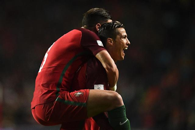 Portugal's Cristiano Ronaldo (R) celebrates with teammate Pepe (L) after scoring against Hungary during their World Cup 2018 qualifier at the Luz stadium in Lisbon on March 25, 2017 (AFP Photo/PATRICIA DE MELO MOREIRA)