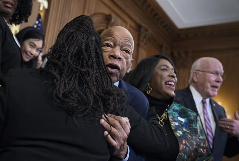 Civil rights leader Rep. John Lewis, D-Ga., is hugged as House Democrats gathered before passing the Voting Rights Advancement Act to eliminate potential state and local voter suppression laws, at the Capitol in Washington, Friday, Dec. 6, 2019. At right is Rep. Terri Sewell, D-Ala., who introduced the bill and who represents Selma, Ala., a city that was at the forefront of the 1960s civil rights movement. They are joined at far right by Sen. Patrick Leahy, D-Vt. (AP Photo/J. Scott Applewhite)
