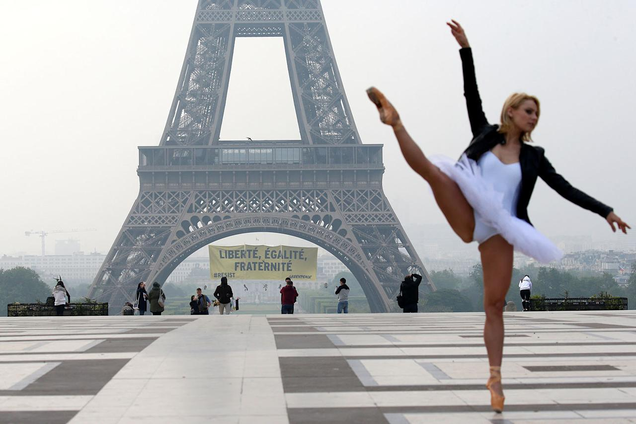 "<p>A ballet dancer attends a photo shooting as activists from the environmentalist group Greenpeace unfurl a giant banner on the Eiffel Tower which reads ""Liberty, Equality, Fraternity"" in a call on French citizens to vote against the National Front (FN) presidential candidate Marine Le Pen, in Paris, France May 5, 2017. (Photo: Gonzalo Fuentes/Reuters) </p>"