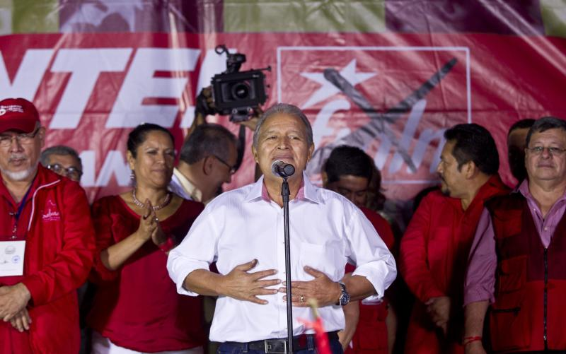 Salvador Sanchez Ceren, presidential candidate, current vice president for the ruling Farabundo Marti National Liberation Front (FMLN) gestures during a demonstration in San Salvador, El Salvador, Sunday, Feb. 2, 2014. El Salvador's electoral tribunal said late Sunday that with about 58 per cent of the votes counted, Vice-President Salvador Sanchez had 49 per cent in his bid to extend the rule of the Farabundo Marti National Liberation Front, the party of former civil war guerrillas that won the presidency for the first time in 2009. Sanchez was just under the 50 per cent plus one vote he needed to win outright, but election tribunal chief Eugenio Chicas predicted the candidate would fall short and have to face a runoff. San Salvador Mayor Norman Quijano was second with nearly 39 per cent as the candidate of the long-governing conservative Nationalist Republican Alliance, known as ARENA. (AP Photo/Esteban Felix)
