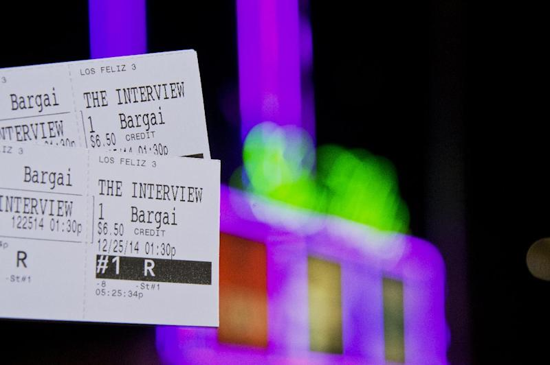 Tickets for the movie 'The Interview' are held in front of the Los Feliz 3 Cinema in Los Angeles, California, on December 23, 2014 (AFP Photo/Robyn Beck)