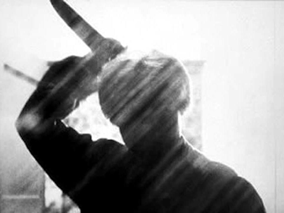 Shadow of a woman with a knife