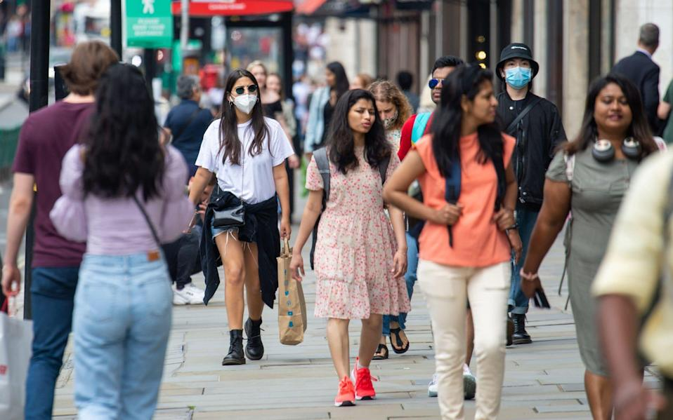 Shoppers on Regent Street today, as the Government confirms that it will soon be mandatory to wear a face mask in shops. - Dominic Lipinski/PA