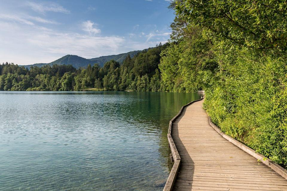 """<p><a class=""""link rapid-noclick-resp"""" href=""""https://www.countrylivingholidays.com/tours/lake-bled-slovenia-munich-walking-tour"""" rel=""""nofollow noopener"""" target=""""_blank"""" data-ylk=""""slk:TAKE IN THE BEAUTY OF BLED"""">TAKE IN THE BEAUTY OF BLED</a></p>"""