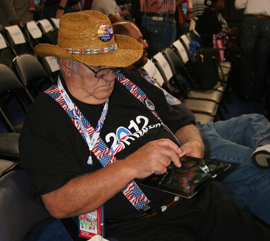A delegate relaxes with his iPad on the arena floor at the Democratic National Convention on Thursday Sept. 6, 2012. (Torrey AndersonSchoepe/Yahoo! News)