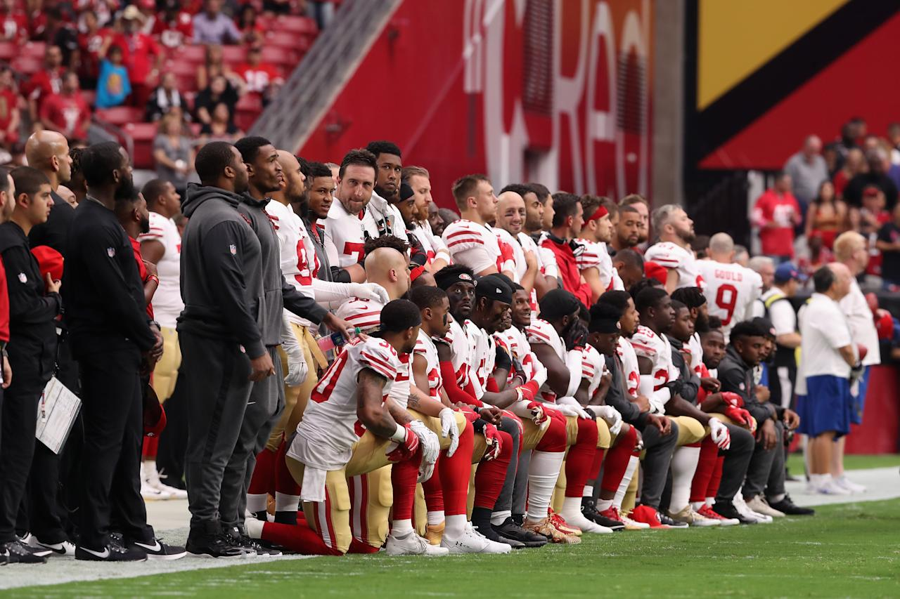<p>Members of the San Francisco 49ers kneel for the National Anthem before the start of the NFL game against the Arizona Cardinals at the University of Phoenix Stadium on October 1, 2017 in Glendale, Arizona. (Photo by Christian Petersen/Getty Images) </p>