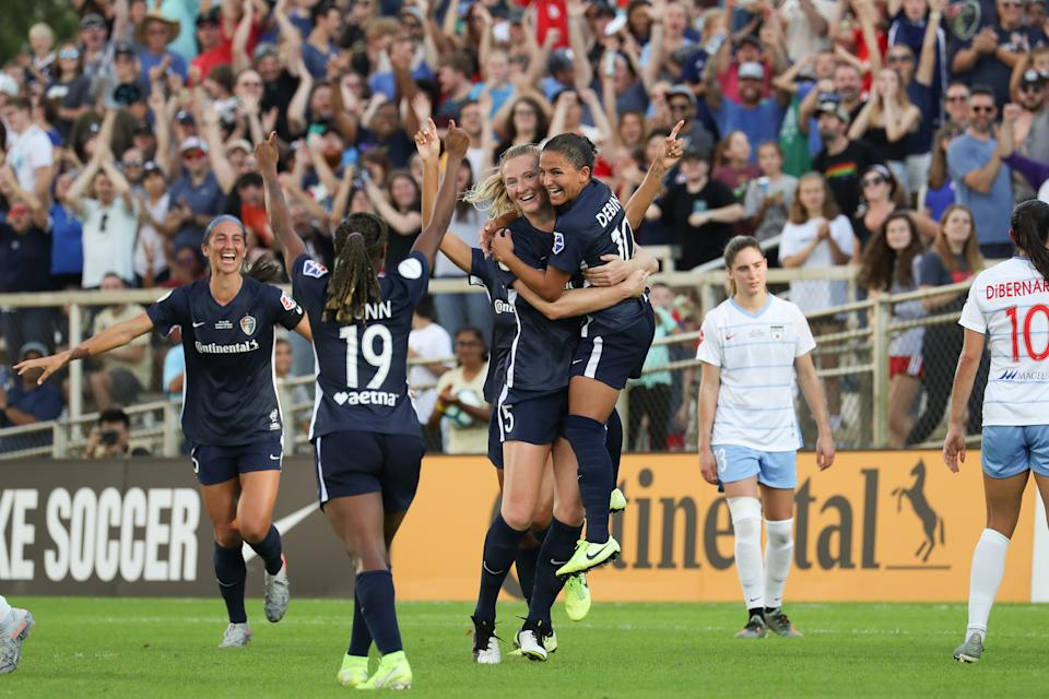 CARY, NC - OCTOBER 27: Samantha Mewis #5 of the North Carolina Courage celebrates scoring with teammates during a game between Chicago Red Stars and North Carolina Courage at Sahlen's Stadium at WakeMed Soccer Park on October 27, 2019 in Cary, North Carolina. The North Carolina Courage defeated the Chicago Red Stars 4-0 to win the 2019 NWSL Championship. (Photo by Andy Mead/ISI Photos/Getty Images).