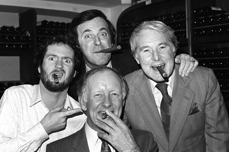 Terry Wogan (back), winner of the Old Court Whisky TV Personality of the Year Award, with three other winners of the monthly event, Kenny Everett (left), Ernie Wise (right), and Frank Bough. (Photo by PA Images via Getty Images)