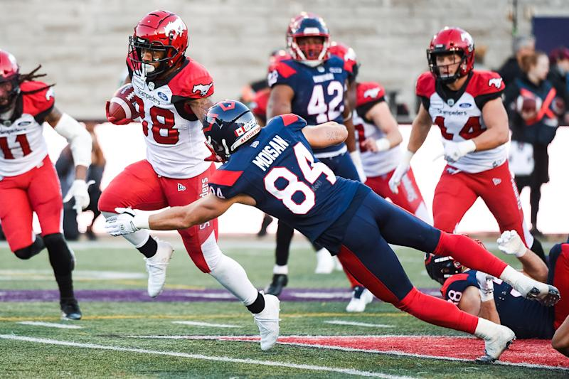 Montreal Alouettes fullback Etienne Moisan (84) tries to tackle Calgary Stampeders defensive back Brandon Smith (28). (Photo by David Kirouac/Icon Sportswire via Getty Images)