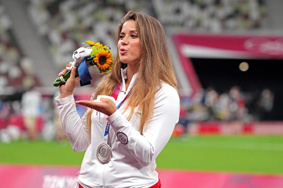 Maria Andrejczyk of Poland celebrates winning the silver medal in women's javelin throw during the Tokyo 2020 Olympic Summer Games at Olympic Stadium.