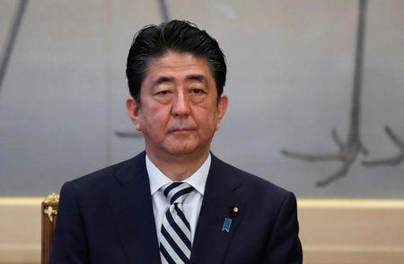 Japan's PM Abe attends a meeting of the Imperial Household Council to discuss the timeline for the abdication of Japan's Emperor Akihito at the Imperial Household Agency in Tokyo
