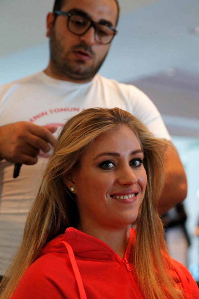 ISTANBUL, TURKEY - OCTOBER 20: Angelique Kerber of Germany attends the Oriflame Style Suite and has her hair done during the previews of the TEB BNP Paribas WTA Championships at the Renaissance Polat Istanbul Hotel on October 20, 2013 in Istanbul, Turkey. (Photo by Dean Mouhtaropoulos/Getty Images)