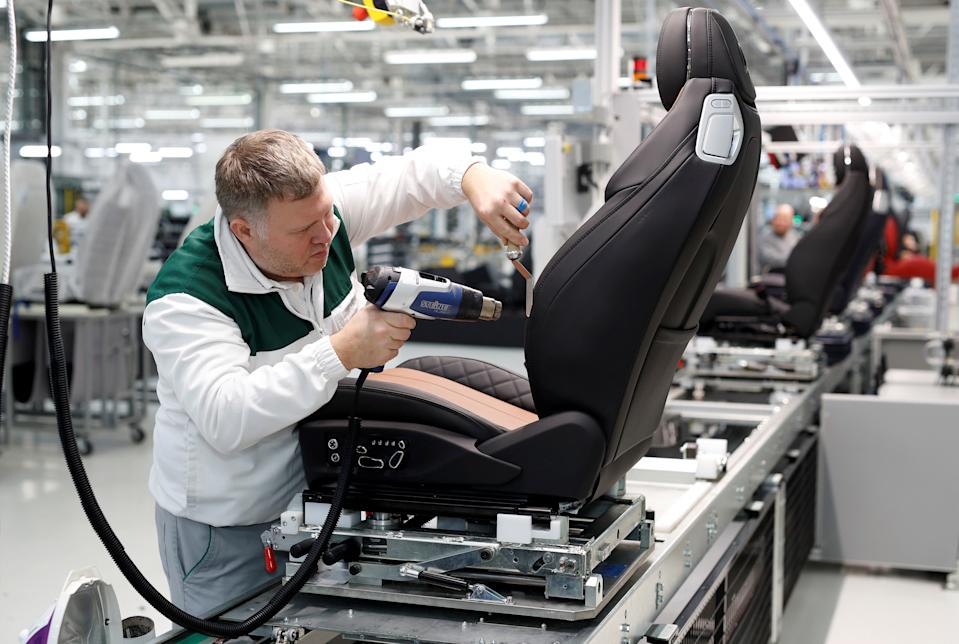A worker irons the leather on a seat at Bentley's manufacturing facility in Crewe, Britain October 15, 2018. Picture taken October 15, 2018.   REUTERS/Darren Staples