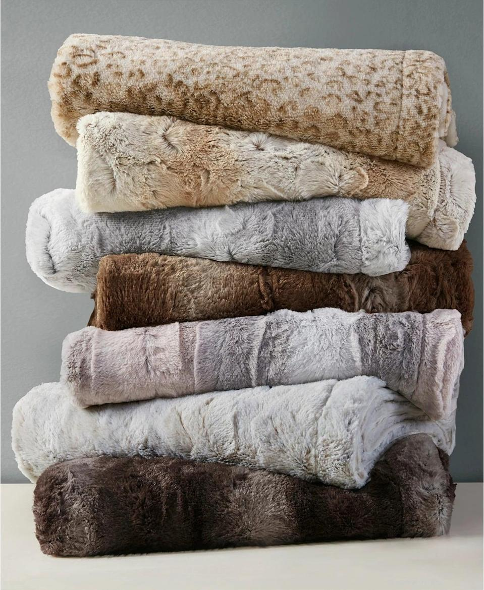 <p>Get cozy with these ultr-soft and luxurious <span>Madison Park Zuri Reversible Faux-Fur Throw</span> ($36, originally $70). It's perfect for dressing up your living space and the ultimate cuddle buddy.</p>