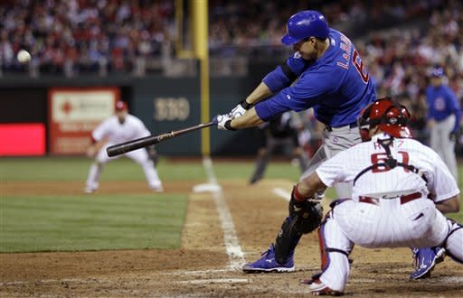 Chicago Cubs' Bryan LaHair hits a two-run home run off Philadelphia Phillies relief pitcher Antonio Bastardo in the eighth inning of a baseball game, Monday, April 30, 2012, in Philadelphia. At right is Phillies catcher Carlos Ruiz. Philadelphia won 6-4. (AP Photo/Matt Slocum)