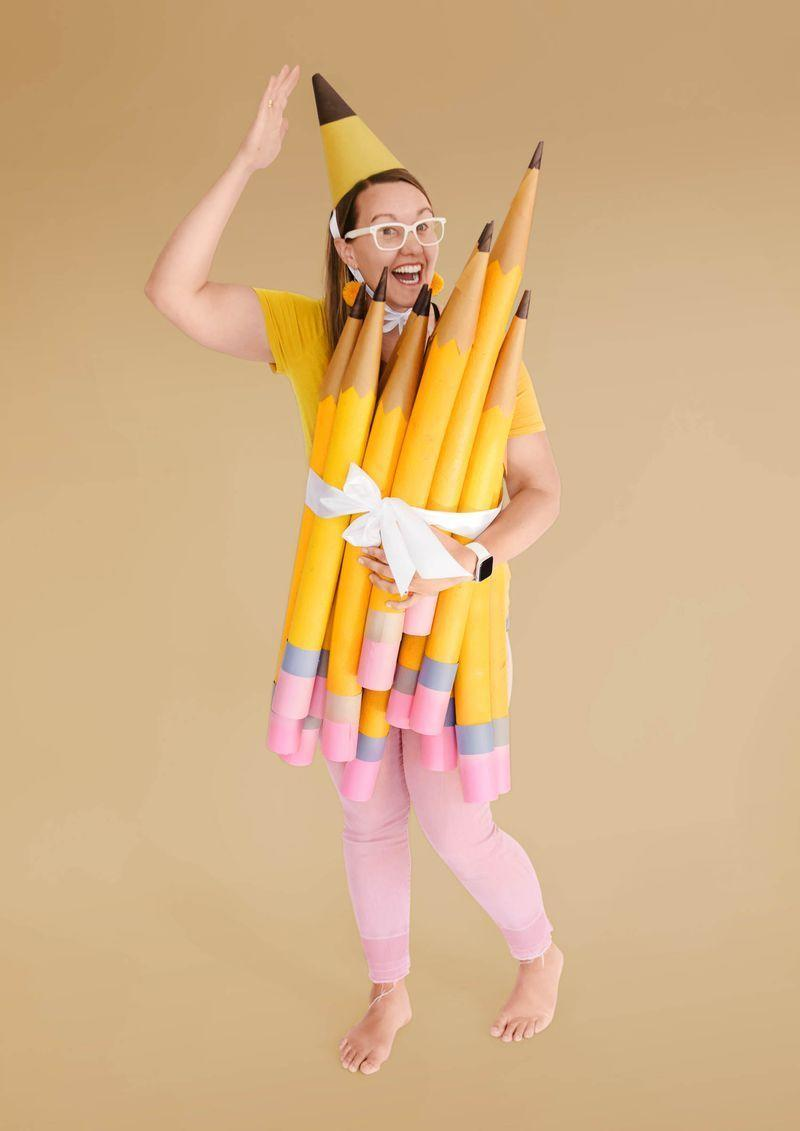 """<p>This costume will have you lookin' sharp!</p><p><strong>Make the costume:</strong> Round up some pool noodles. Coat the summer staple with yellow spray paint (try Rust-Oleum American Accents in Marigold); add brown paper-cone tips. Wrap ends with pink and gray craft paper to make erasers. Secure the bundle around yourself with ribbon. Extra credit for a corresponding pointy party hat.</p><p><strong>Get the tutorial at <strong><a href=""""https://ohyaystudio.com/a-bouquet-of-newly-sharpened-pencils-costume-and-how-much-i-love-youve-got-mail/"""" rel=""""nofollow noopener"""" target=""""_blank"""" data-ylk=""""slk:Oh Yay Studio"""" class=""""link rapid-noclick-resp"""">Oh Yay Studio</a></strong>.</strong></p><p><a class=""""link rapid-noclick-resp"""" href=""""https://www.amazon.com/Oodles-Noodles-Deluxe-Foam-Pool/dp/B01LBEX84S/ref=sr_1_1_sspa?linkCode=ogi&tag=syn-yahoo-20&ascsubtag=%5Bartid%7C10050.g.23785711%5Bsrc%7Cyahoo-us"""" rel=""""nofollow noopener"""" target=""""_blank"""" data-ylk=""""slk:SHOP POOL NOODLES"""">SHOP POOL NOODLES</a></p>"""