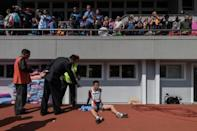 High-fives and presidential portraits at Pyongyang Marathon