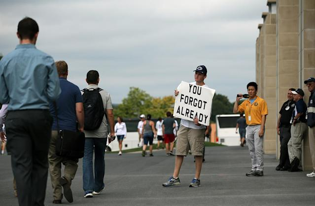 <p>Andrew Limauro, a sophomore from Pittsburgh Pa., stands outside Beaver Stadium protesting the school's decision to honor former head coach Joe Paterno, before Penn State takes on Temple in an NCAA college football game in State College, Pa., Sept. 17, 2016. Paterno was fired in 2011 amid the Jerry Sandusky child sex abuse scandal. (Photo: Chris Knight/AP) </p>