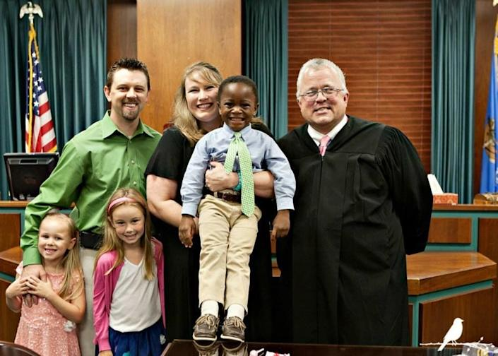 """""""After six monthswith himin the U.S., this family was all smiles that they were finally able to finalize their son's adoption."""" -- Mary Morrow"""