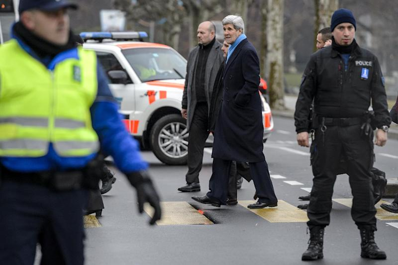 US Secretary of State John Kerry (C) after holding talks with Tehran's top diplomats on Iran's nuclear program, in Geneva, Switzerland, on February 23, 2015 (AFP Photo/Fabrice Coffrini)