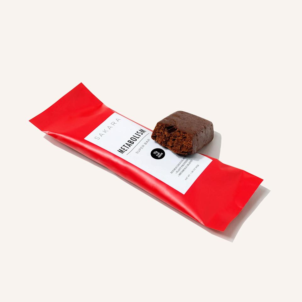 """<h2>Sakara Metabolism Super Bar</h2><br>""""This month, I drove four hours down to my parents' house to surprise my mom for Mother's Day. I'm convinced that these new Sakara protein bars (and a great road trip playlist) are what got me through the drive. They have an almost-bittersweet cocoa flavor that I really jive with, and each bar has 12 grams of plant protein and 10 grams of fiber to keep things moving. I can't say for sure if it does anything for my metabolism, but it makes for the best healthy snack ever."""" <em>– KH</em><br><br><strong>Sakara Life</strong> Metabolism Super Bar, $, available at <a href=""""https://go.skimresources.com/?id=30283X879131&url=https%3A%2F%2Fwww.sakara.com%2Fproducts%2Fmetabolism-super-bar"""" rel=""""nofollow noopener"""" target=""""_blank"""" data-ylk=""""slk:Sakara"""" class=""""link rapid-noclick-resp"""">Sakara</a>"""