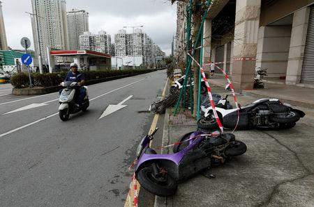 Motorcycles tipped over by strong wind from tropical storm Pakhar in Macau