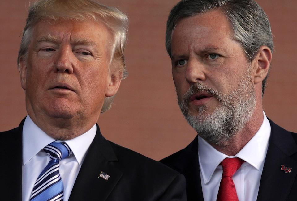 <p>U.S. President Donald Trump (L) and Jerry Falwell (R), President of Liberty University, on stage during a commencement at Liberty University May 13, 2017 in Lynchburg, Virginia</p> (Photo by Alex Wong/Getty Images)