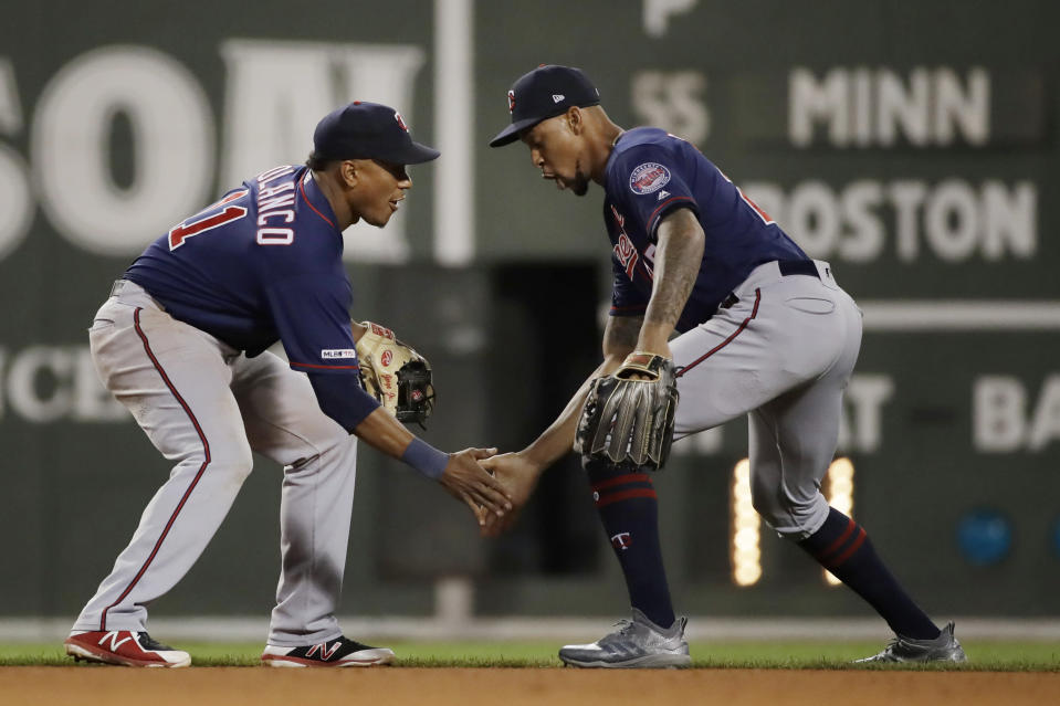 Minnesota Twins' Jorge Polanco, left, and Byron Buxton (25) celebrate the team's 6-5 victory over the Boston Red Sox in a baseball game at Fenway Park, Tuesday, Sept. 3, 2019, in Boston. (AP Photo/Elise Amendola)