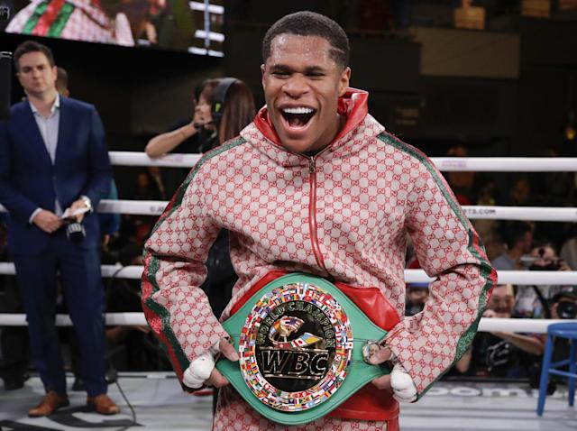 Devin Haney poses with the WBC interim lightweight: AP