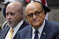 FILE - This photo from Friday Sept. 11, 2020, shows former New York Mayor Rudolph Giuliani, right, and former New York City police Commissioner Bernard Kerik, left, during the Tunnel to Towers ceremony in New York. Kerik, a longtime Giuliani friend who was pardoned by former President Donald Trump for felony convictions, said Giulani called him as federal agents were searching his home on Wednesday, April 28, 2021. (AP Photo/Mark Lennihan, File)