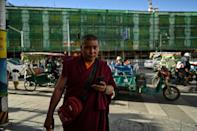 A huge infrastructure and building drive in Tibet has brought airports, roads, railways and new flats, which Beijing says are improving life across the remote mountainous plateau -- but the boom is also changing the historic Buddhist city of Lhasa